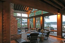 Screen Porch Fireplace by Glass Uppers Protect Outdoor Fireplace On Screened Porch