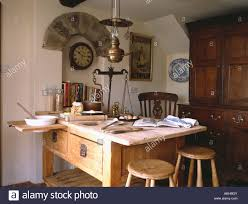 antique brass scales on victorian bakers table in country kitchen