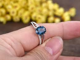 london blue topaz engagement ring 1 2 carat oval london blue topaz engagement ring with diamond 14k