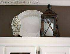 Decorating Above Kitchen Cabinets Ideas by Studio 5 Decorating Above Your Kitchen Cabinets Decorating