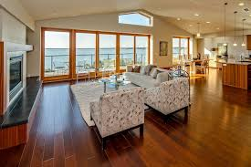 modern great room with pendant light laminate floors in
