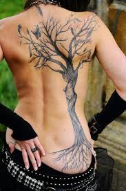 tree with roots and butterfly on back for tattoos