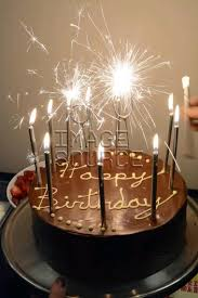 birthday cake sparklers chocolate birthday cake with sparklers and candles rm stock photo