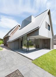 a contemporary addition to an existing dutch house design milk