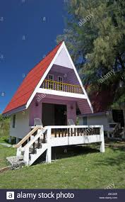 pastel coloured red roof a frame bungalow andaman beach resort ko