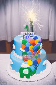 birthday cake sparklers birthday cake with candles and sparklers stock photo getty images