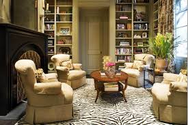 interior faux zebra skin rug with cream upholstered chair and