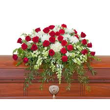 enduring strength casket spray from seasons floral