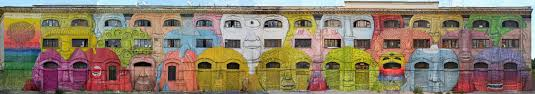 blu s massive new mural in rome turns 48 windows into faces colossal view full detail