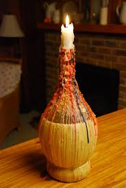 recycled wine bottles made into a hurricane candle holder diy and