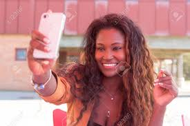 Take A Selfie Young African Student Making A Pause To Take A Selfie Stock Photo