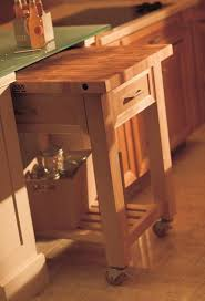 rolling island cart stored under countertop create an extra work