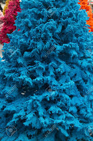 of colored trees flocked in blue closeup