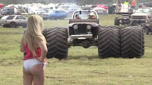 muddy truck monster mud trucks mashing at epic mud party bog in south florida