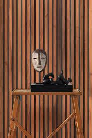 timber strips wallpaper in teak on black by piet hein eek for nlxl