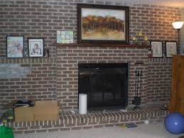 brown leather sofa combined with white brick fireplace placed on f