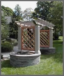 pergola with trellis arbour with gothic trellis u0026 stone planters