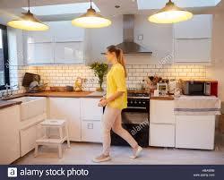 stylish kitchen mid woman walking in stylish kitchen stock photo royalty
