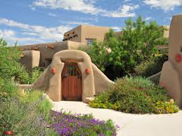 pueblo style house plans the exterior of this new mexico adobe style home uses orange paint