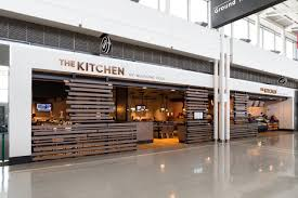 the kitchen by wolfgang puck now open at dulles international