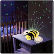 childrens night light projector bedtime night light stock photo reading book bed dark