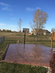 the concrete slab basketball court is great exercise for the whole