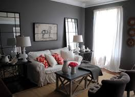 living room gray sofa white table lamps black coffee table gray
