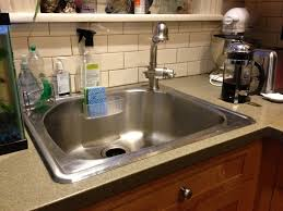 kitchen corner kitchen sink with stainless steel faucet and