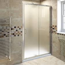bathroom bathroom rug with frosted shower door glass and towel