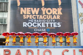 radio city rockettes reveal nyc banner atop marquee theater pizzazz