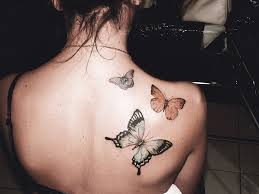 small butterfly tattoo on neck back in 2017 real photo pictures