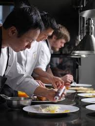 sous chef cuisine chef duncan ly sous chef jinhee prepare dishes during black