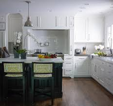 white kitchen black island white kitchen with black island and yellow ikat counter stools