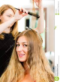 hair colour download at the hairdresser woman gets new hair colour stock photo image