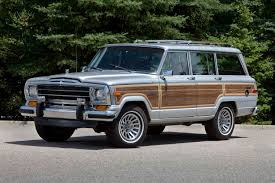 i would totally drive this old skool jeep grand wagoneer probably