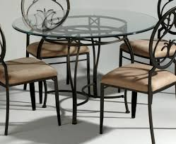 adorable decorating ideas using oval black iron tables in glass