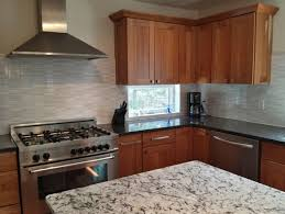 ideas granite countertops and kitchen hood with mosaic tile