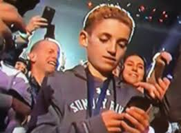 Phone Meme - phone kid becomes 2018 s first hilarious meme at the super bowl