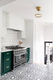 best images about flooring pinterest herringbone wide modern vintage kitchen with cabinets benjamin moore forest green open shelving and cement