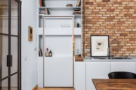 a hidden passageway makes each room in this berlin flat a private