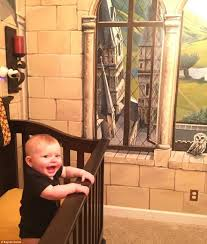 harry potter inspired nursery in illinois has a dumbledore finley daniel seemingly loves the harry potter themed nursery created for him