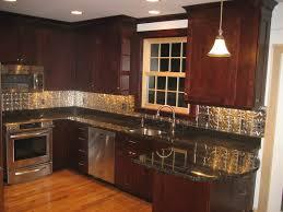 interior white kitchen backsplash with sky blue glass subway