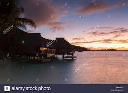 overwater bungalows of le maitai hotel at dawn bora bora society