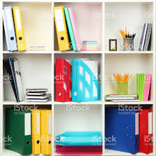white office shelves with different stationery close up stock