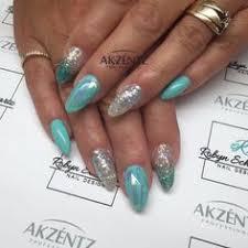 teal glitters and gel polish on natural nails blingy nails