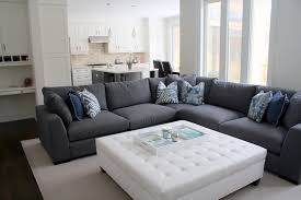 oversized ottoman family room contemporary with blue wall beige sofa