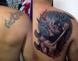 on shoulder blade cover up tattoos