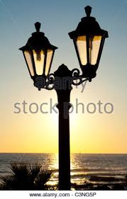 ornamental lights silhouetted against the setting sun on the