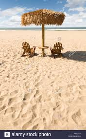 Two Beach Chairs Two Beach Chairs And Umbrella On A Beautiful Ocean Front With Copy