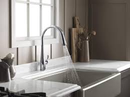 bathroom interesting kohler kitchen faucets for modern kitchen kohler kitchen faucets with small windows and wooden cabinet for modern kitchen ideas